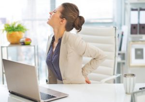 office-back-pain-ergonomics-AdobeStock_67545989_WM