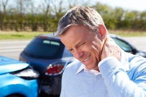 man holding neck after auto accident