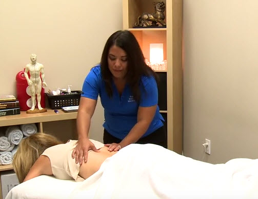 A Randolph Pain Relief & Wellness acupuncturist works with a patient